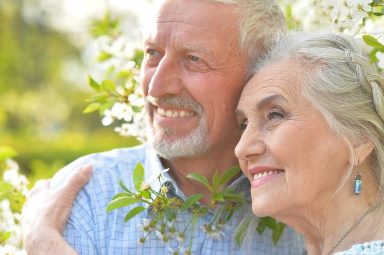 Outdoor portrait of a happy senior couple